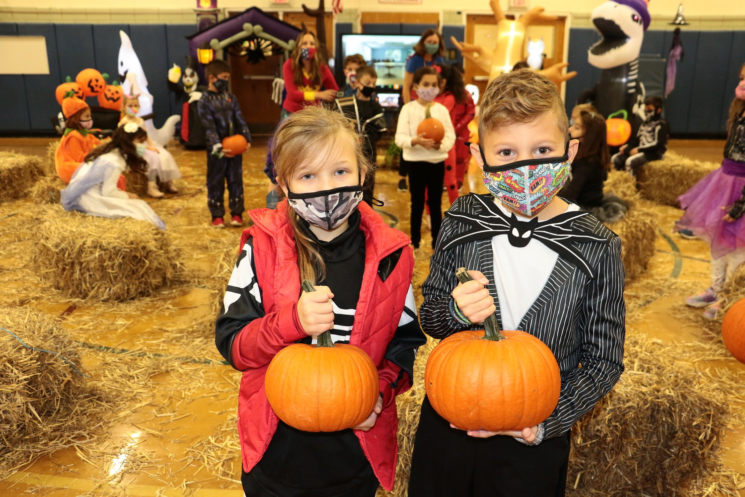 Second-graders Ciana Simoniello, left, and Andreas Koutsagelos looked their best while cruising around the pumpkin patch.