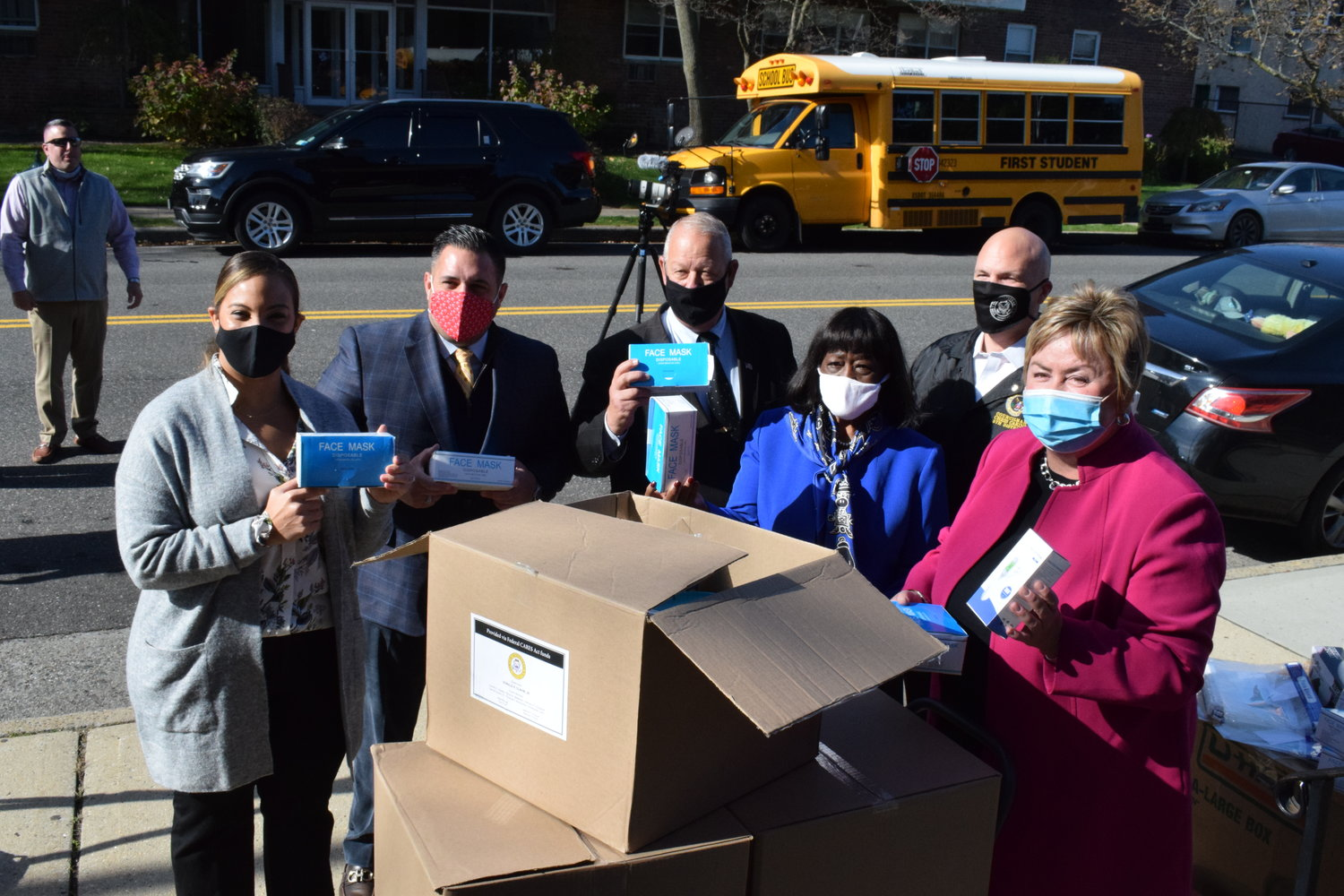 Jenny Jorge, of the Freeport Chamber of Commerce, far left, joined Hempstead Town Councilman Anthony Esposito, Freeport Mayor Robert Kennedy, Town Councilwoman Dorothy Goosby, Councilman Christopher Carini and Town Clerk Kate Murray to help distribute thousands of PPE items for local businesses.