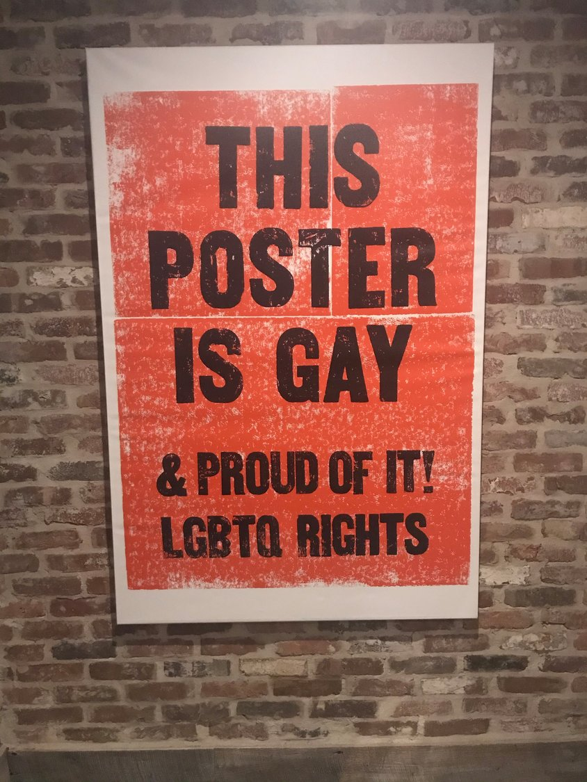 A poster inside the bar supports those who are lesbian, gay, bisexual, transgender and queer.