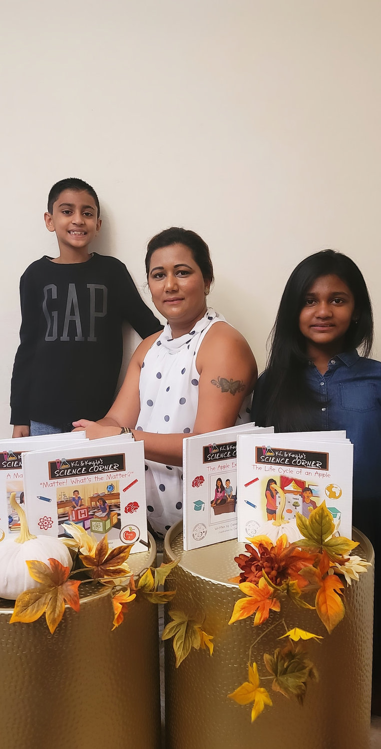 Malvernite Carol Basdeo said she was inspired by her children, K.C., 8, and Kayla, 10, to write her series of science books.