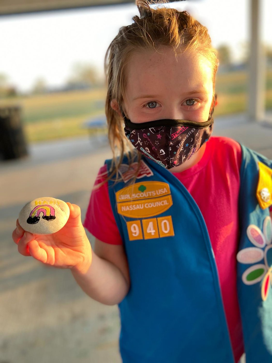 Girl Scout Devyn Keaveny, of Troop 940, drew a pink and yellow rainbow on her rock.