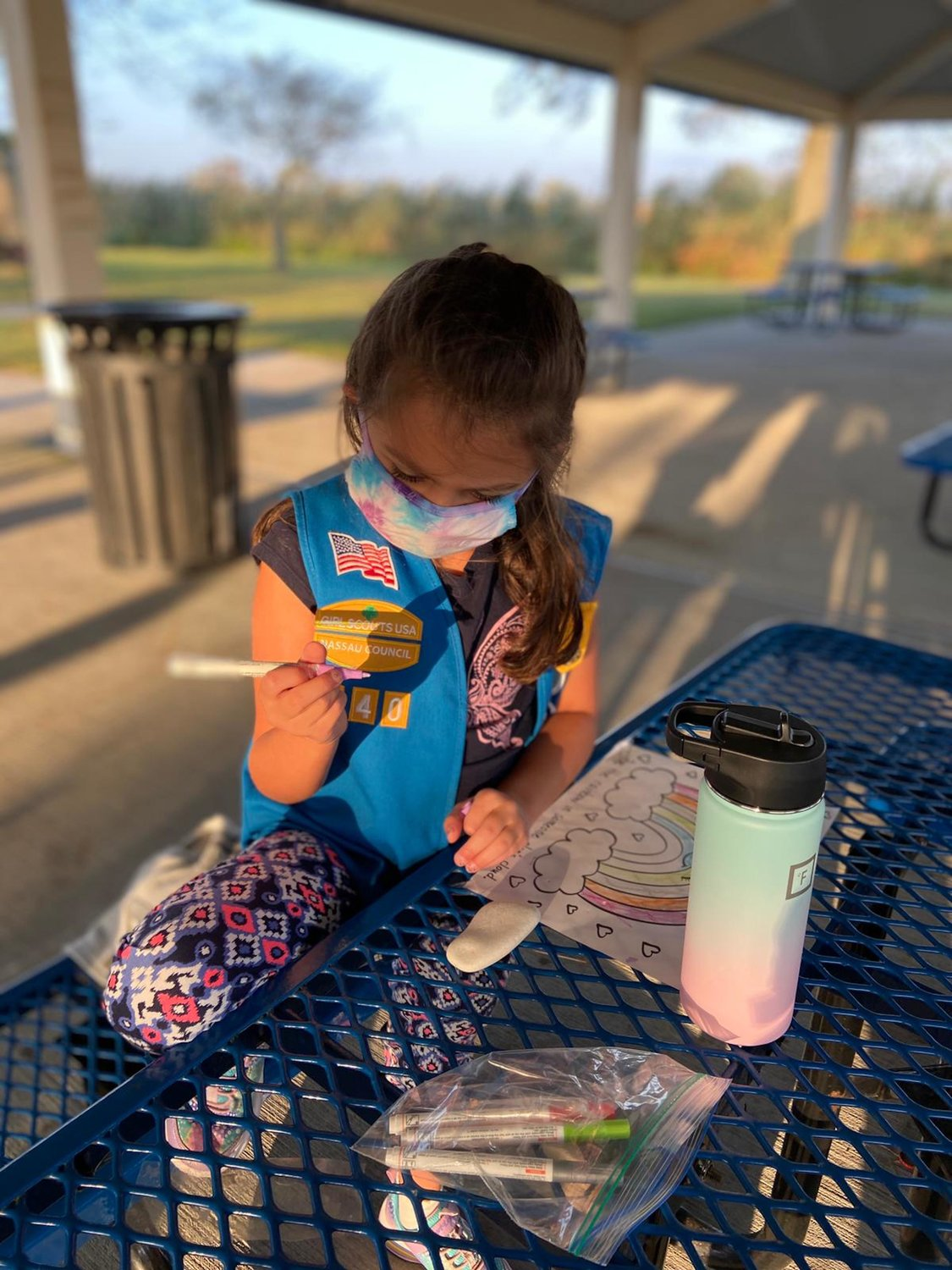 Girl Scout Angelica Nardo, of Troop 940, thought carefully about which colors she would use to color the blank canvas of her rock.