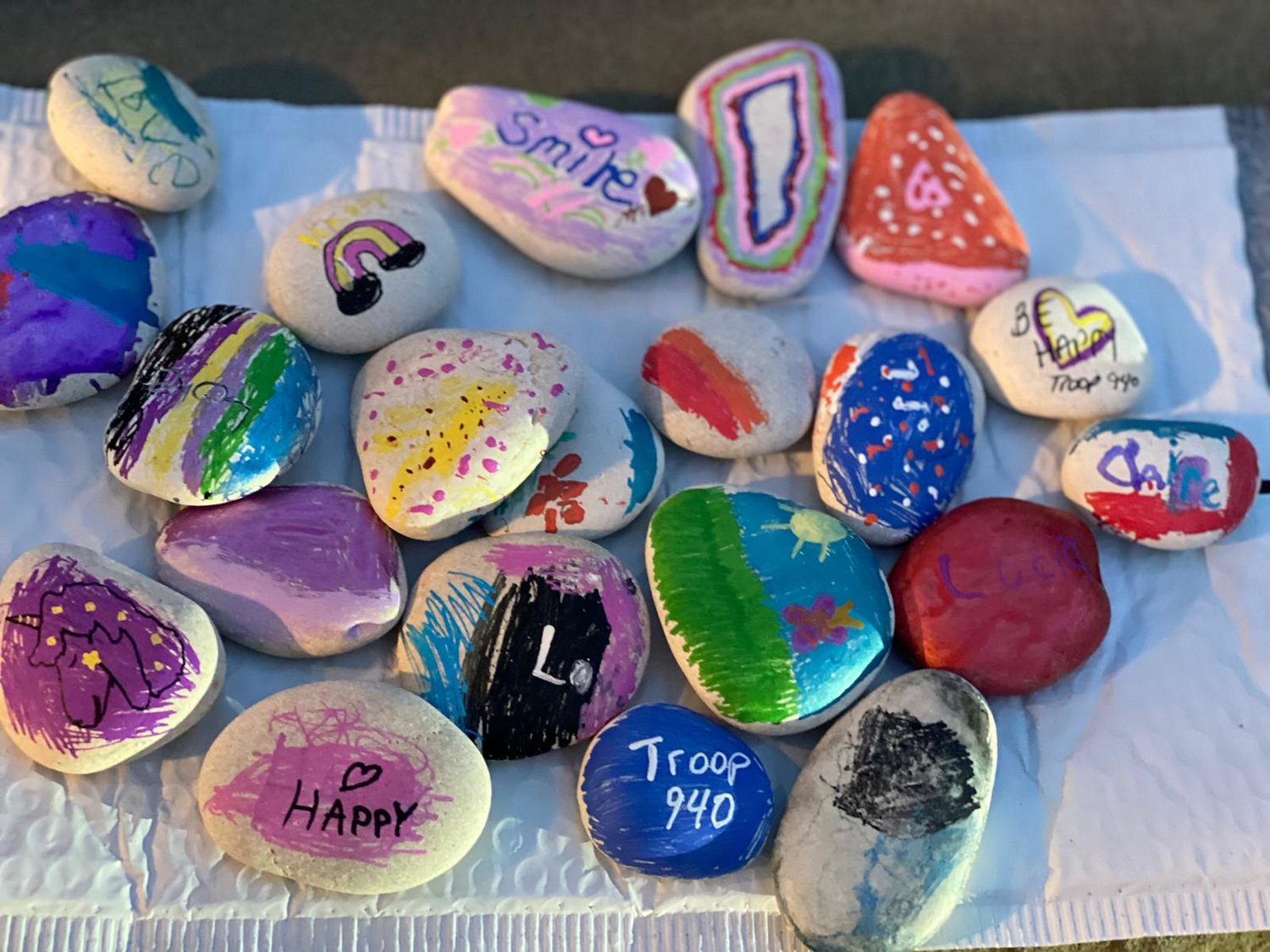 The rocks feature bright colors, eye-catching designs, positive messages and inspirational words.