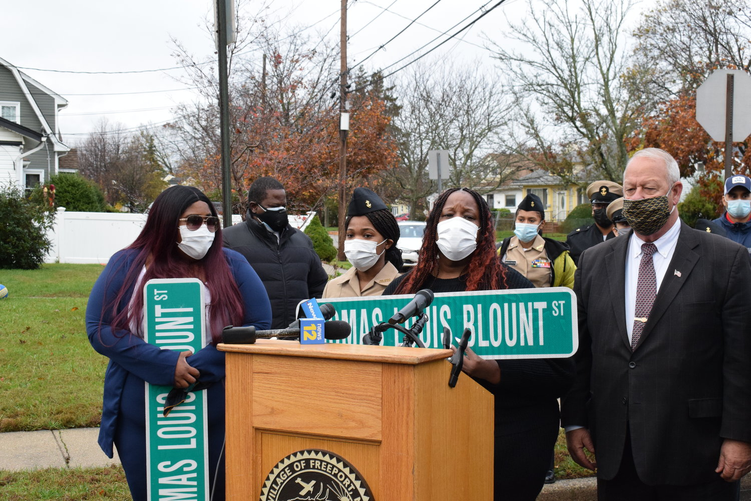 The family of Thomas Blount, Alanna Troy, left, Jaidan Hill and Yvonne Blount thank Freeport Mayor Robert Kennedy for renaming a section of E. Dean Street after the late veteran.