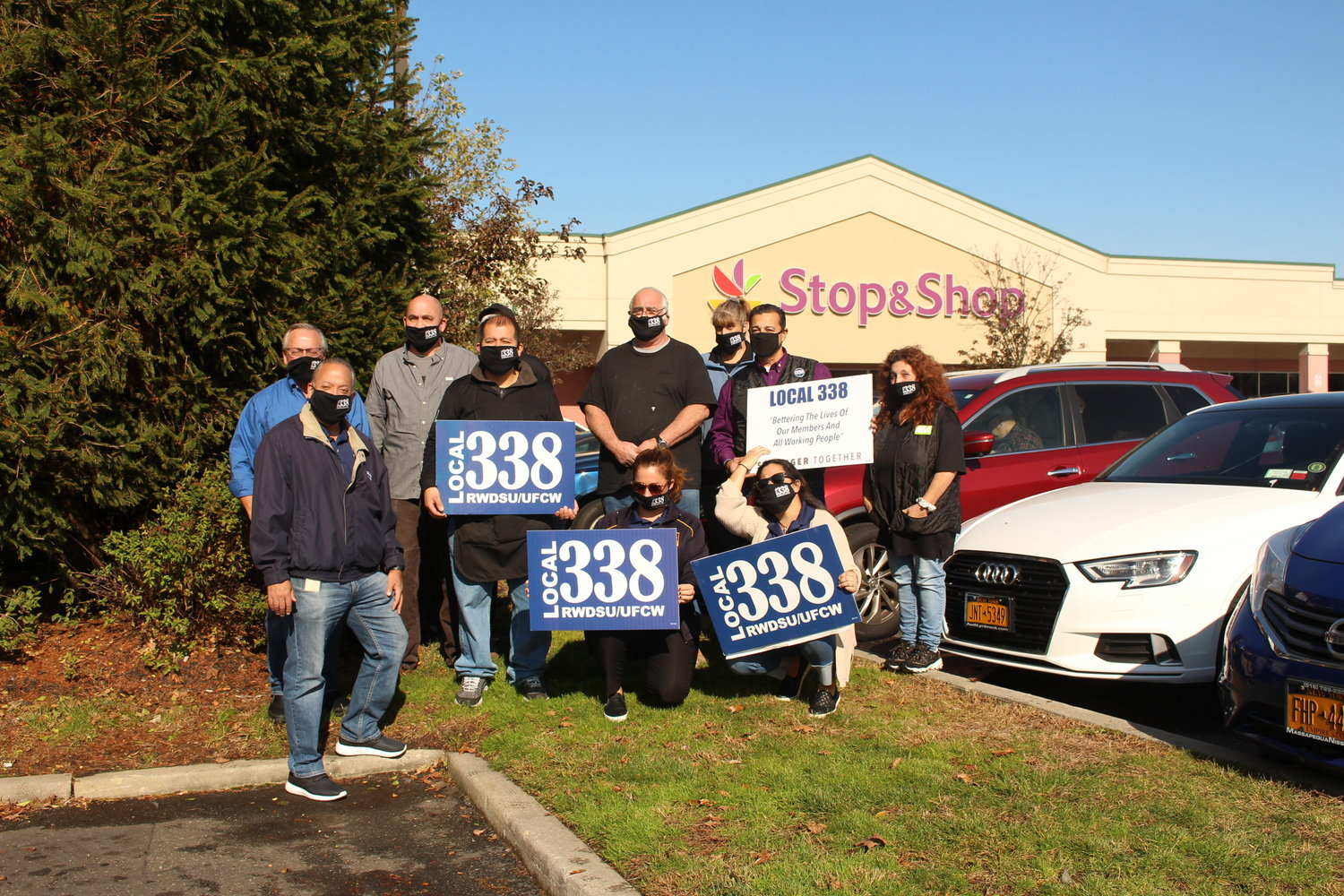 A group of Stop & Shop employees and Local 338 members outside their workplace last Friday after a news conference at which officials announced essential workers could be tested for coronavirus for free.