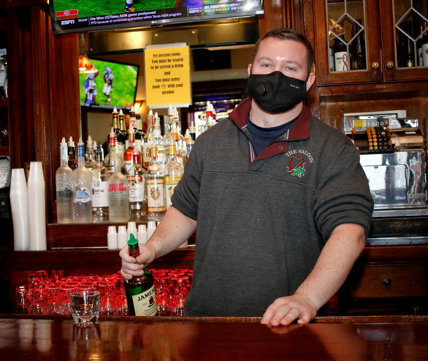 Phil Garry, owner of the Saloon, on West Beech Street, above, said the pandemic has negatively impacted his business and added that new restrictions wouldn't help.