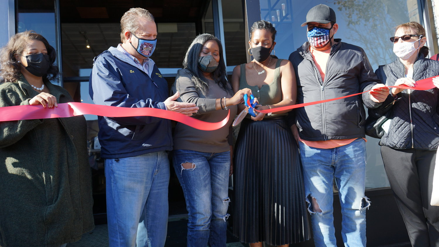 State, village and chamber of commerce representatives joined with Standard Pour co-owners Darlene Gomez, third from left, and Shanelle County to celebrate the ribbon cutting and grand opening of their new boutique coffee shop.