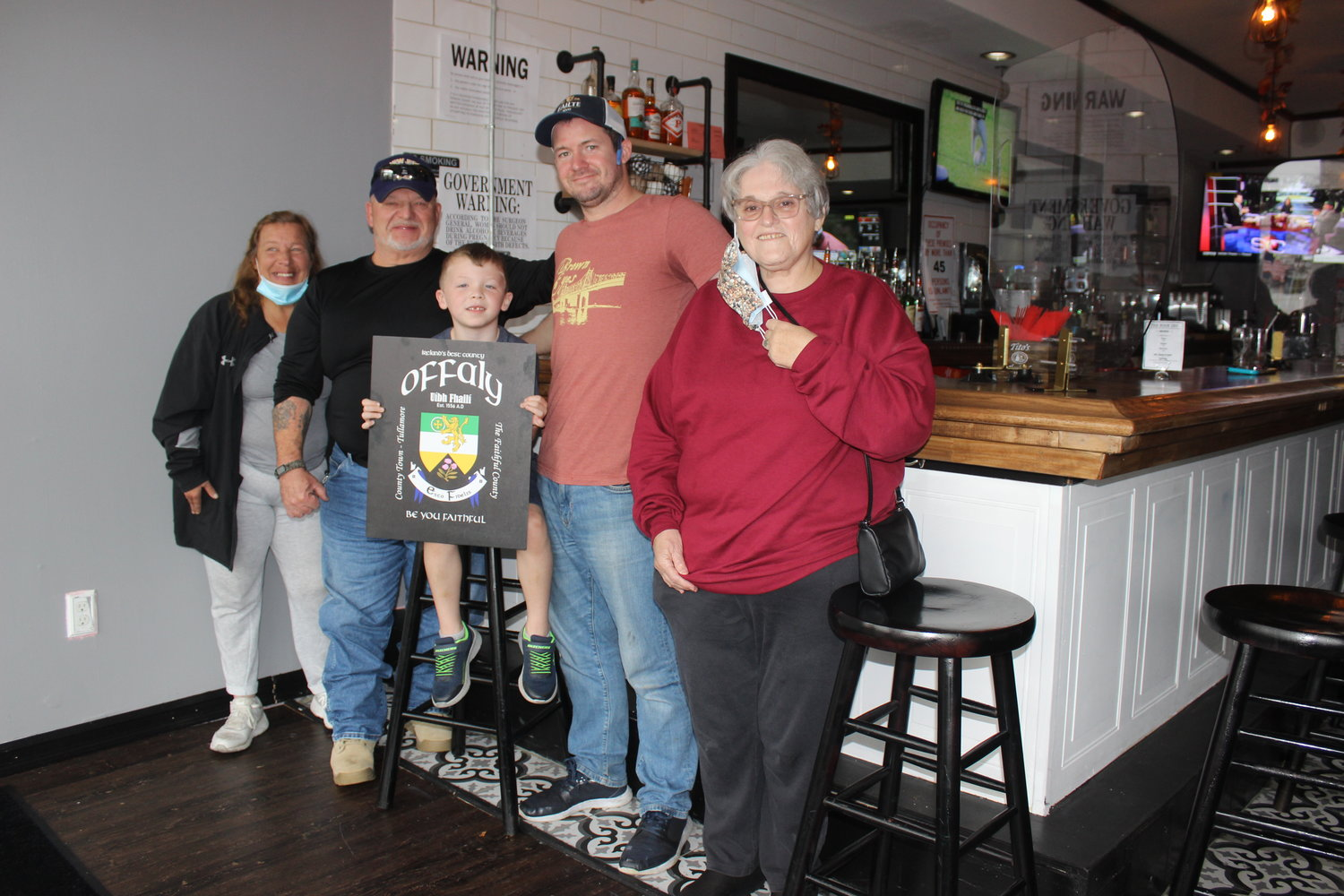 After losing touch decades ago, cousins from Offaly, Ireland, reconnected on Facebook, and discovered that they both live in East Meadow. Kathy Marsolais, left, met Danny Price, second from right, at his bar, the Noon Inn, with her uncle Mike McDonald, second from left, Price's son, Fin, 5, and Marsolais's mother, Betty.