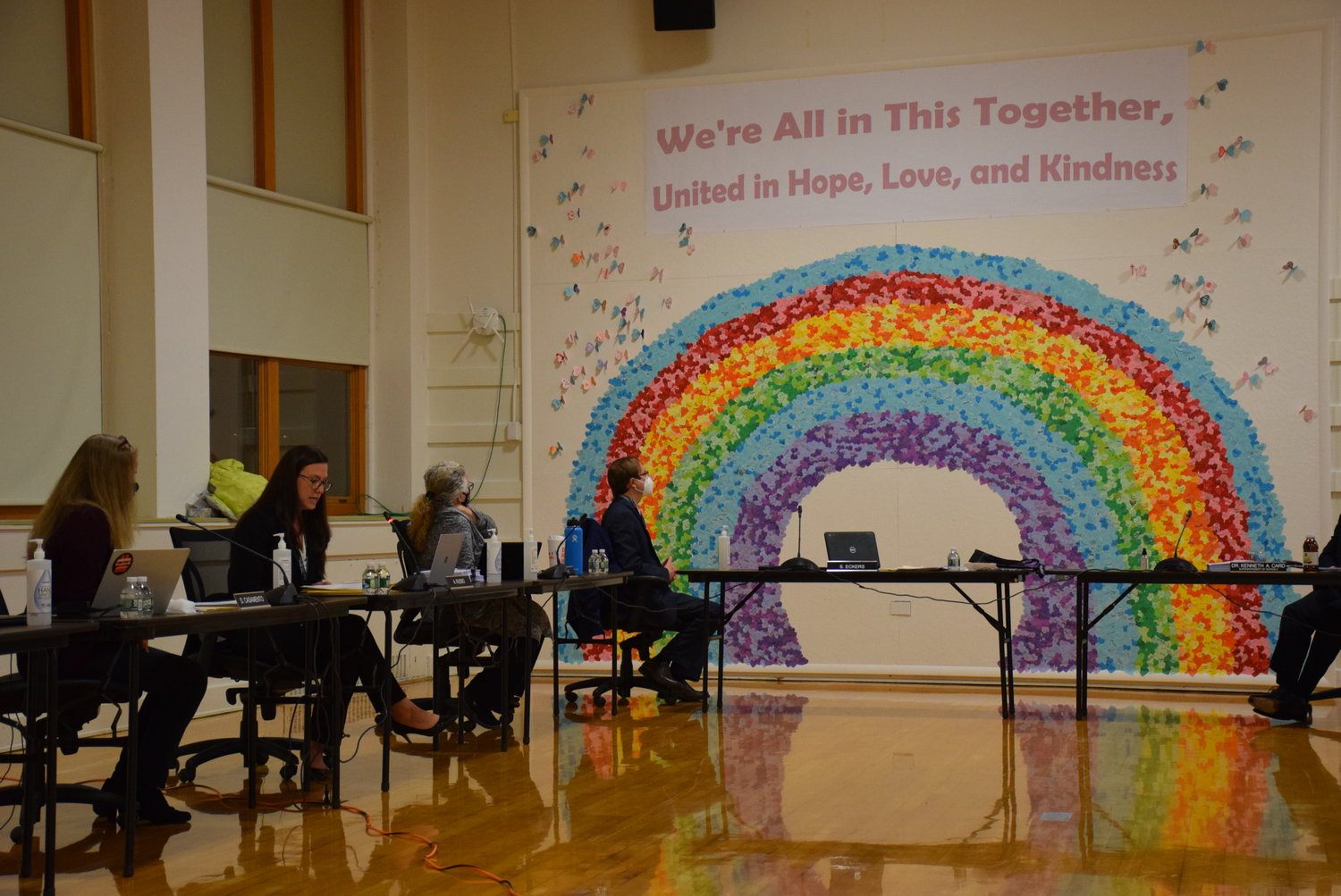Veronica Nicastro, East Meadow PTA Council president, and Kelly Gelfer, director of music and art, presented the board with the completed Unity Day mural at the board's meeting on Nov. 18.