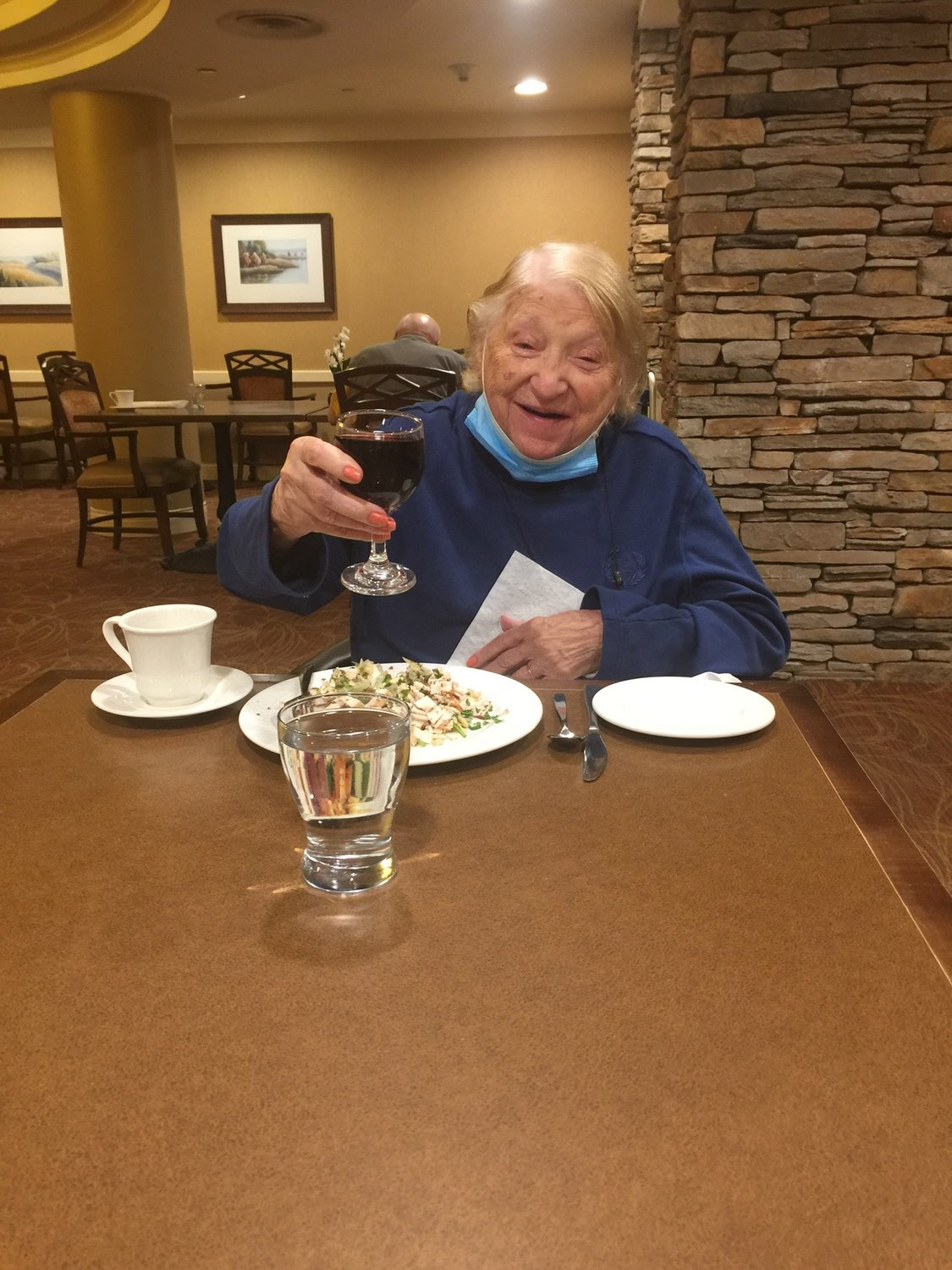 Atria Glen Cove resident Gloria Panaro enjoyed dining from a social distance.