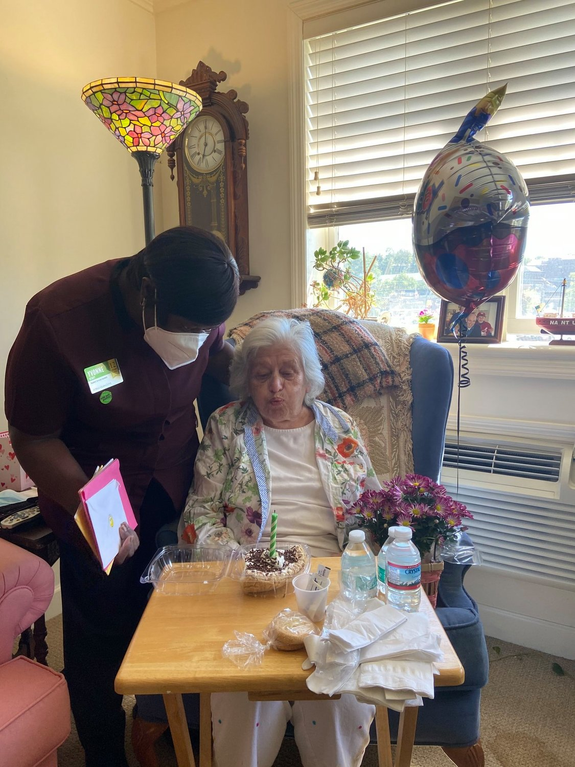 Atria Glen Cove staff member Yvonne Henry, left, made sure to give resident Alberta Maggio a special birthday amid a pandemic.