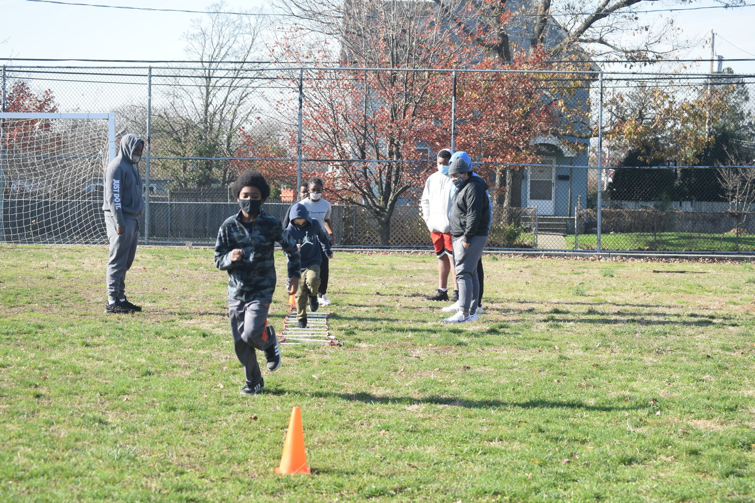 Tristan Primer ran through one of the agility drills at the youth football clinic at the Five Towns Community Center in Lawrence on Nov. 21.