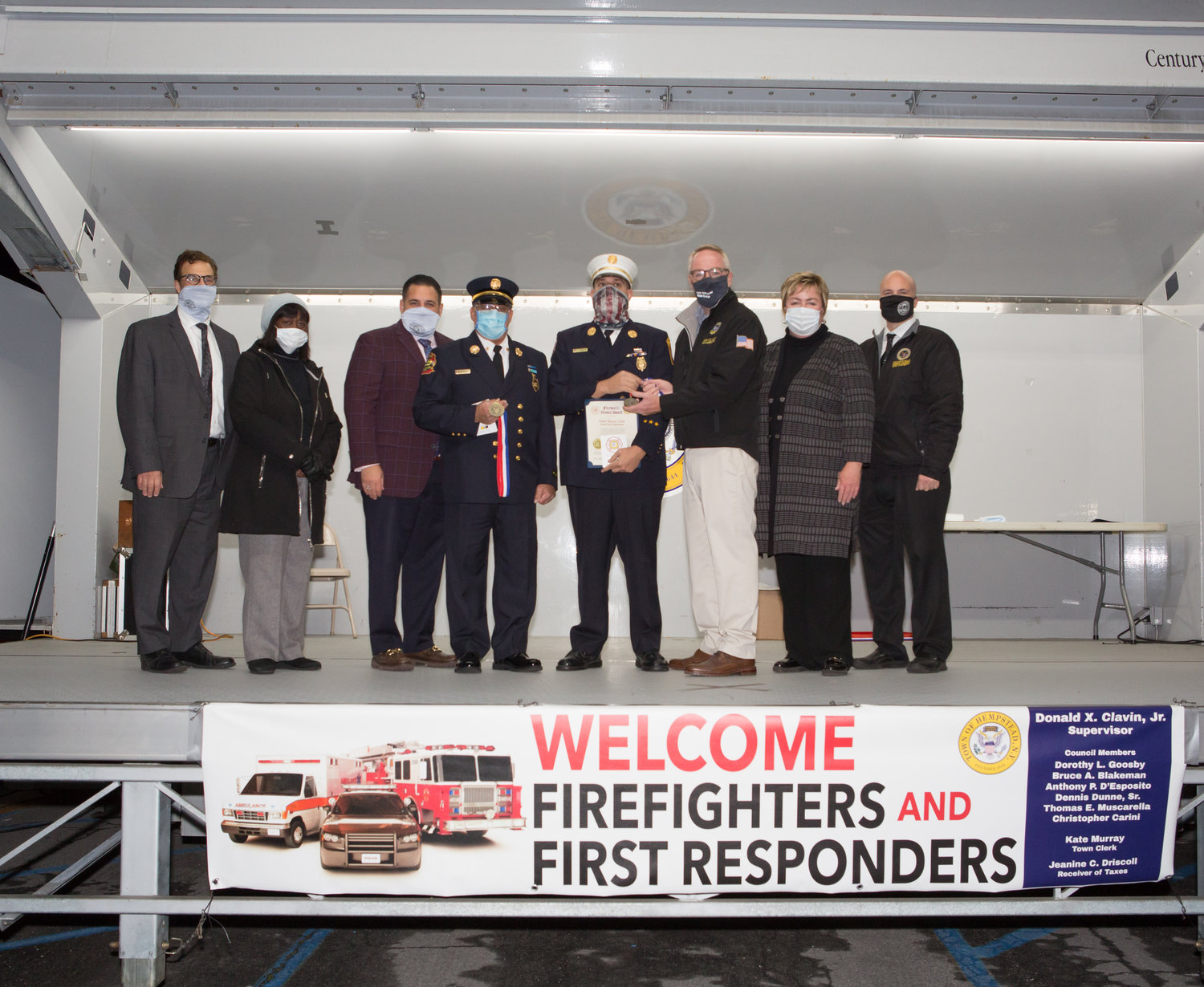 Hempstead town officials hosted a drive-thru firematic awards ceremony. From left were Council people Tom Muscarella, Dorothy Goosby and Anthony D'Esposito, Chief Anthony Rivelli Jr. and ex-Chief Thomas Pandolfo, Town Supervisor Don Clavin, Town Clerk Kate Murray and Councilman Chris Carini.