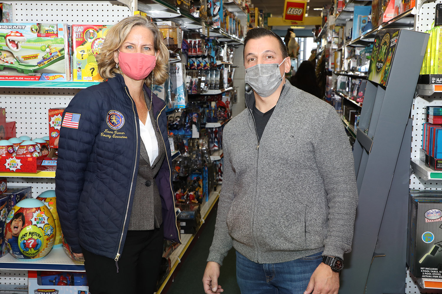 Nassau County Executive Laura Curran with Sean McQuade, owner of Matty's Toy Stop, at a news conference on Nov. 20.