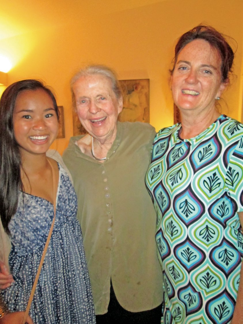 Over her 101 years of life, Isabel Sefton, center, helped raise four different generations of family members, including her eldest daughter, Julia, right, and granddaughter, Isabel, left.