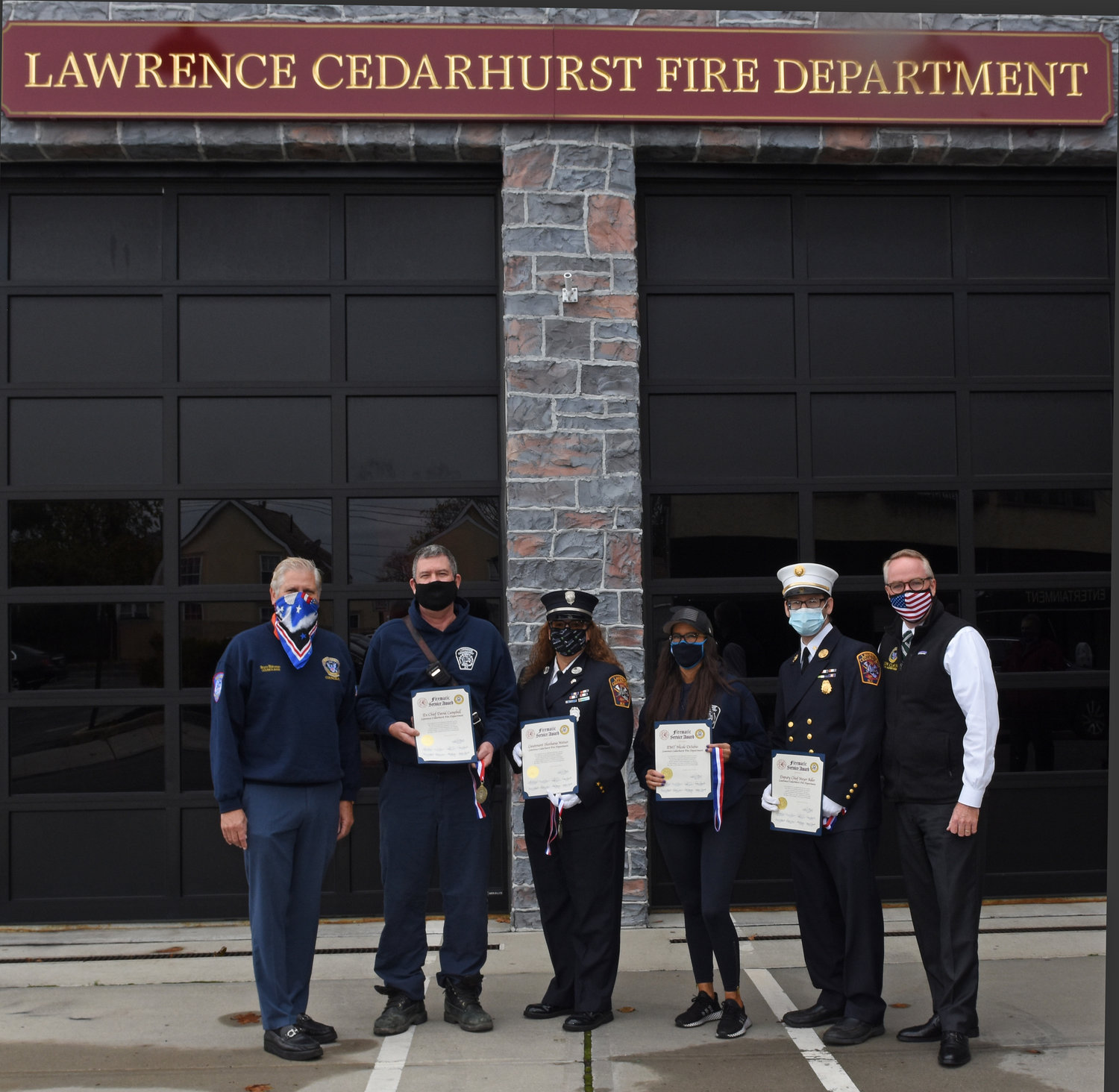 Hempstead town officials presented firematic awards to Lawrence-Cedarhurst Fire Department members. From left were Councilman Bruce Blakeman, Ex-Chief David Campell, Lt. Shoshona Weiner, EMT Nicole Disibio and 2nd Deputy Chief Meyer Adler.
