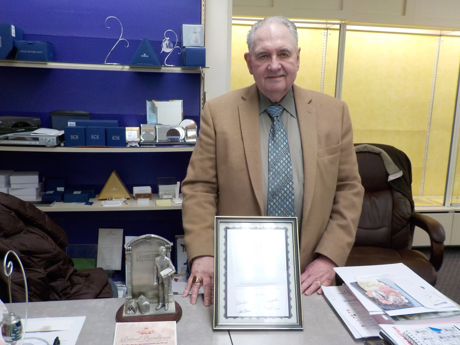 Gaylor displayed documents and awards that the Lyn Gift Shop had earned over the years for excellence in retail as a Hallmark store. He died on Nov. 28 at 79, but leaves behind a legacy in the village.