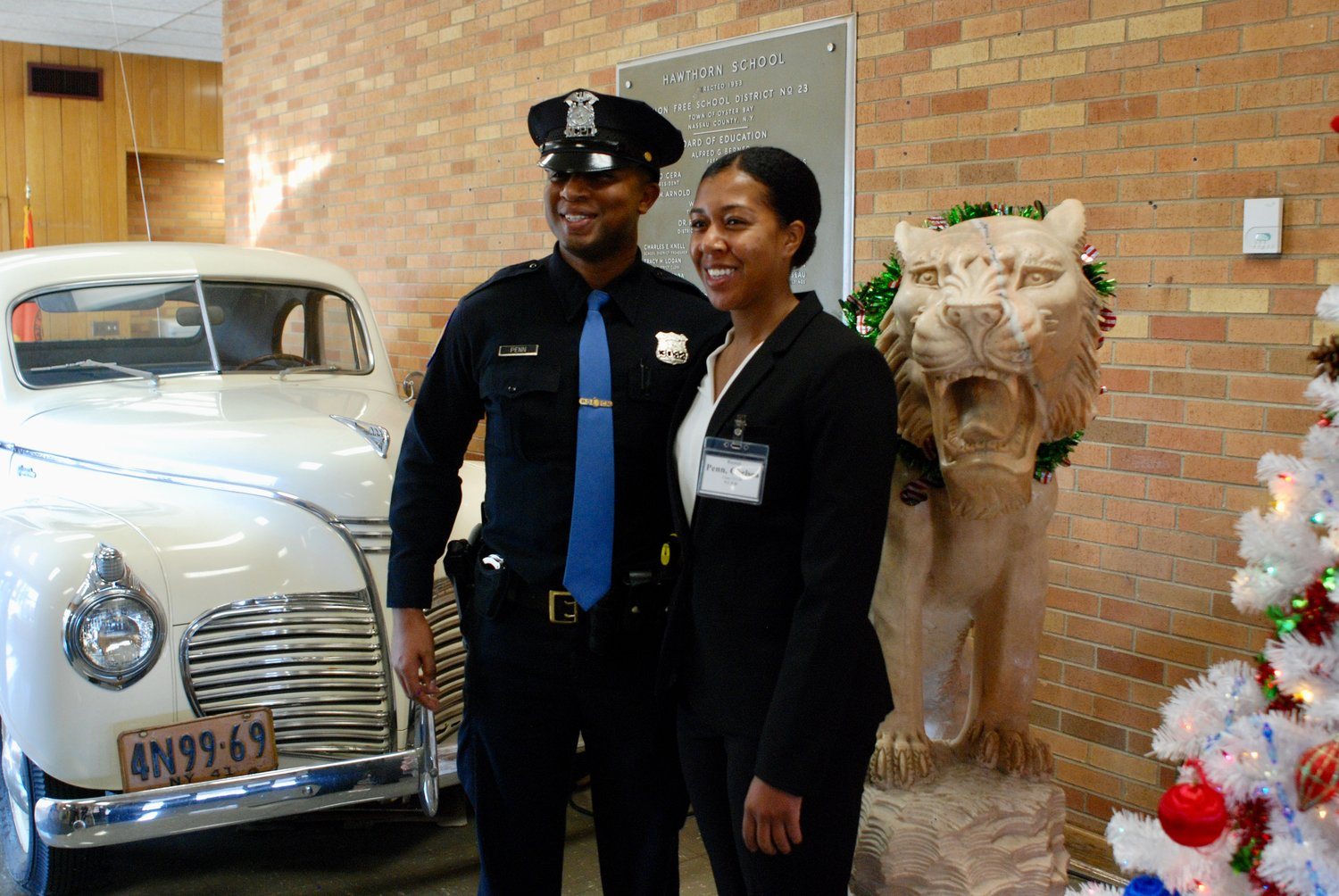 Police recruit Chelsea Penn was joined at the swearing-in by her brother, Derrick Penn, an officer with the NCPD's 8th Precinct.