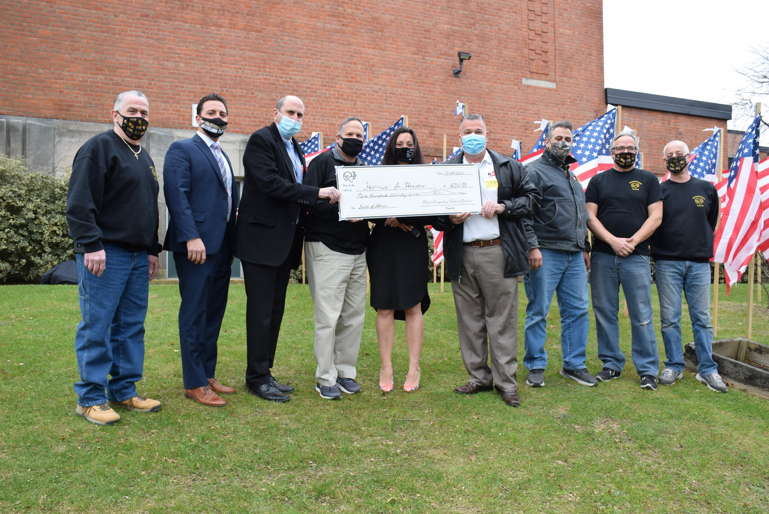 West Hempstead High School donated $920 raised through their Field of Honor to Homes for Heroes on Dec. 8.