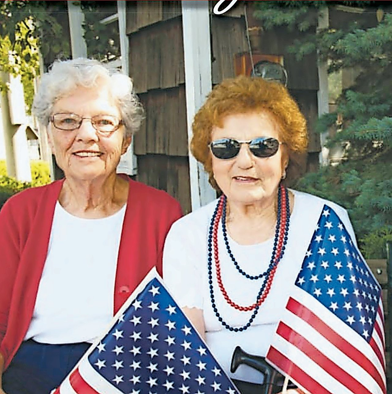 Luce, left, was featured on the cover of the 2013-14 edition of Merrick Herald's Community Guide with Chris Doundoulakis, with whom she attended Merrick's annual Declaration of Independence reading.