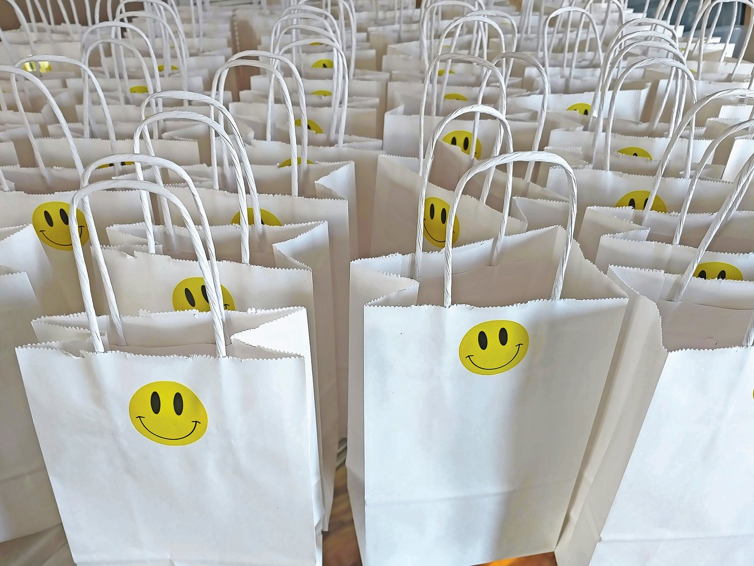 Smile bags, top, became so popular within the community that Howell-Fehling had to recruit a team to help her deliver them.