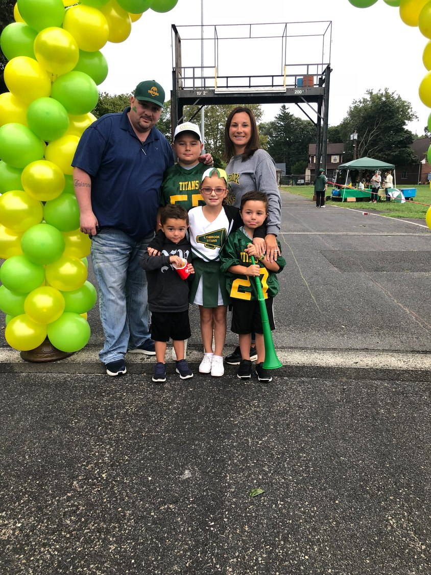 Lanzello is active in Lynbrook and other communities. Above, Lanzello with his wife, Lisa, and their children, Darron, center, and, from left, Gavin, Arianna and Mason.