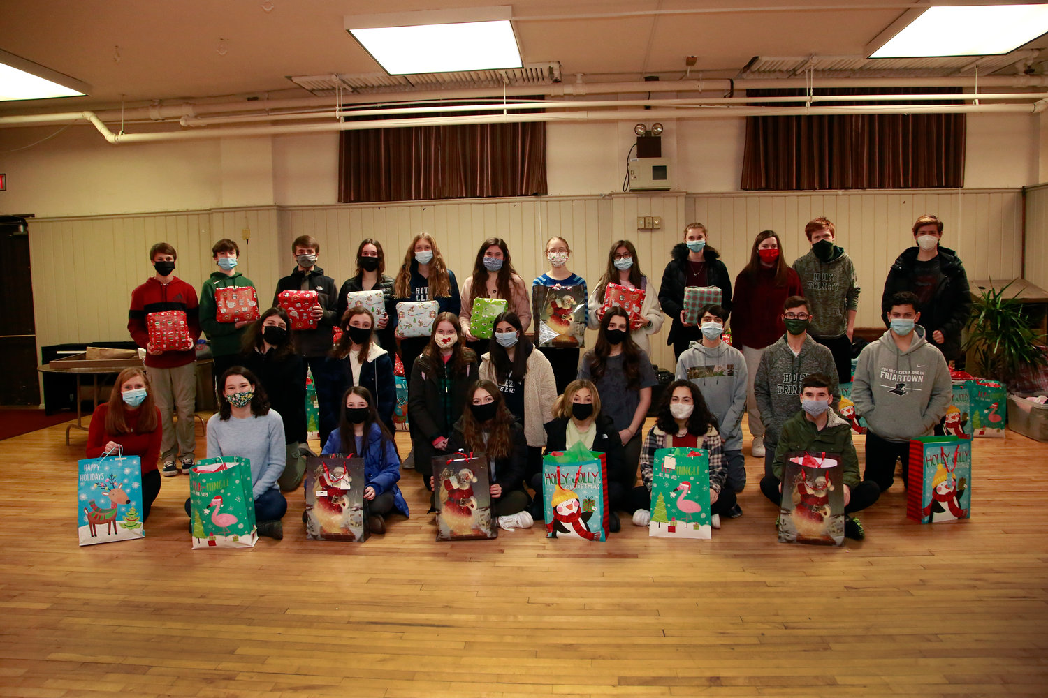 Baldacchino, bottom left, and the Youth Ministry prepared gift bags and monetary donations for the Glory House.