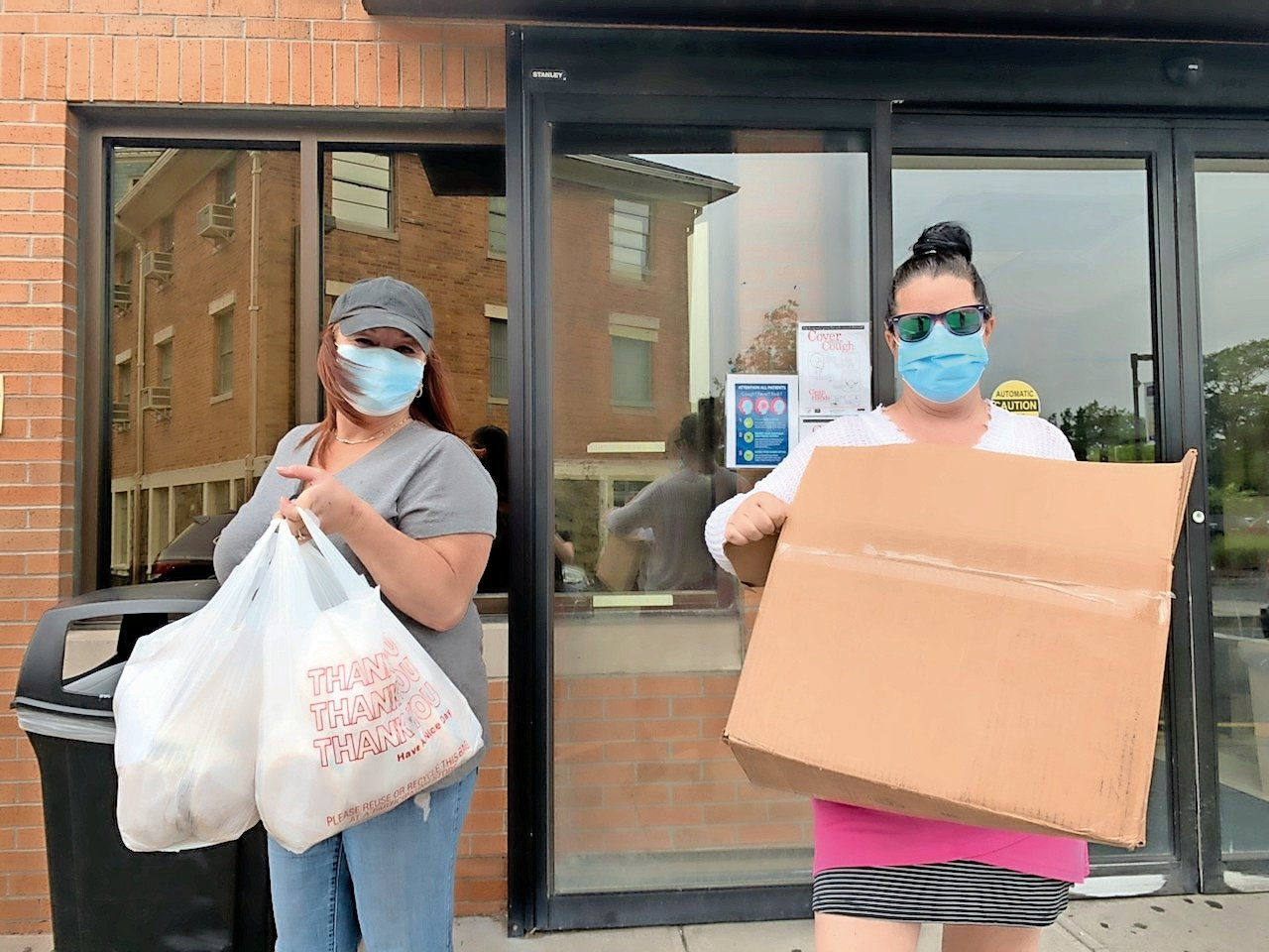 Last spring, Gina Caggiano of North Village Tavern, near right, and Wettstein picked up donations to be delivered to essential workers.