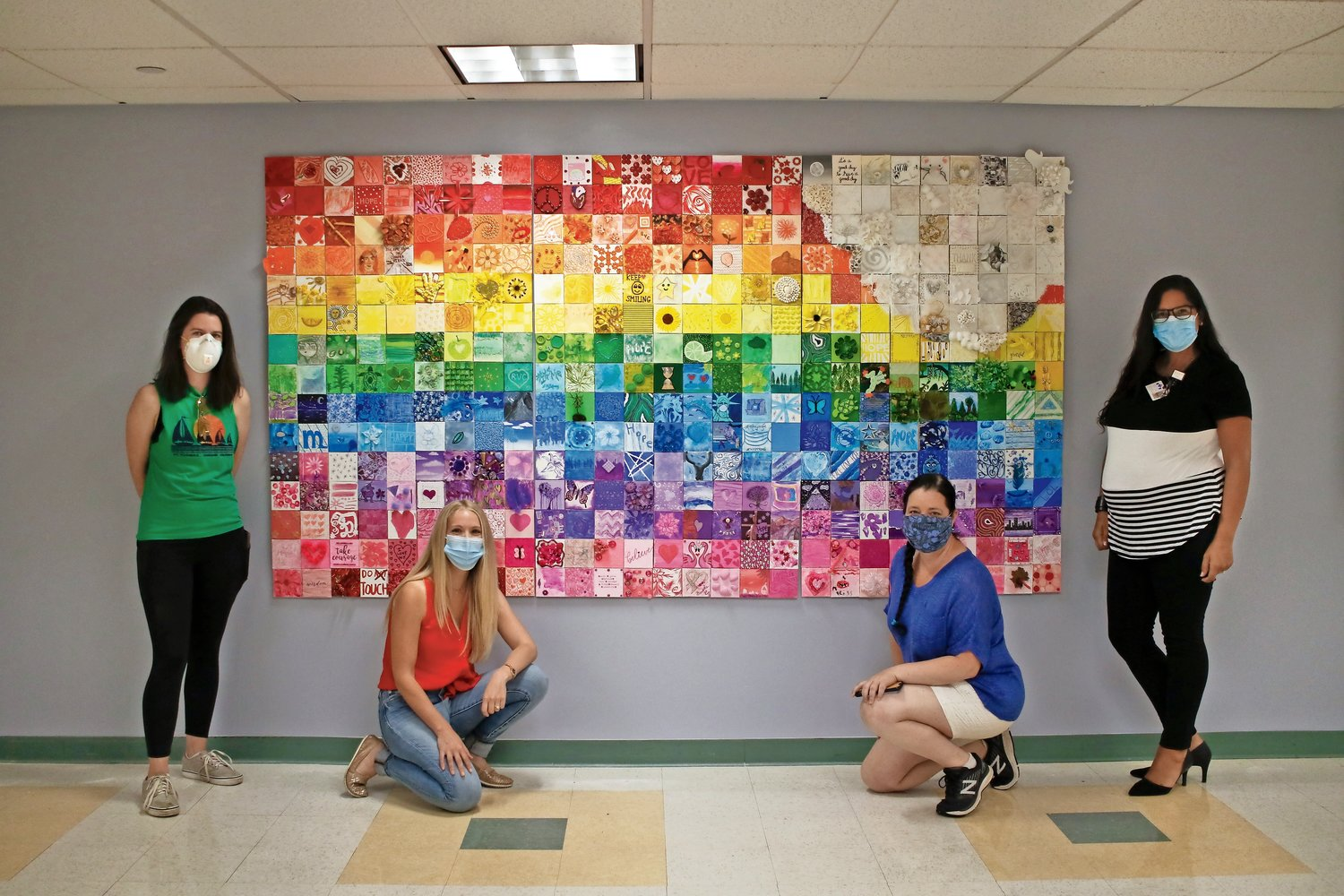 In July, the Support for Local Everything Facebook group teamed up with Hue art studio to put together a rainbow mural, above, that now hangs in the cafeteria at Mercy Hospital. From left were Kristen Conaty, Laura Montaruli, Michele James Wettstein and Alida Almonte-Giannini.