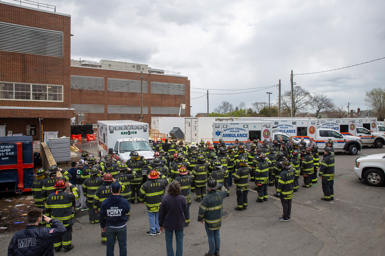 Members of the Valley Stream Fire Department assembled outside South Sinai South Nassau to salute Field shortly after his death. He died in the line of duty after transporting a Covid-19 patient.