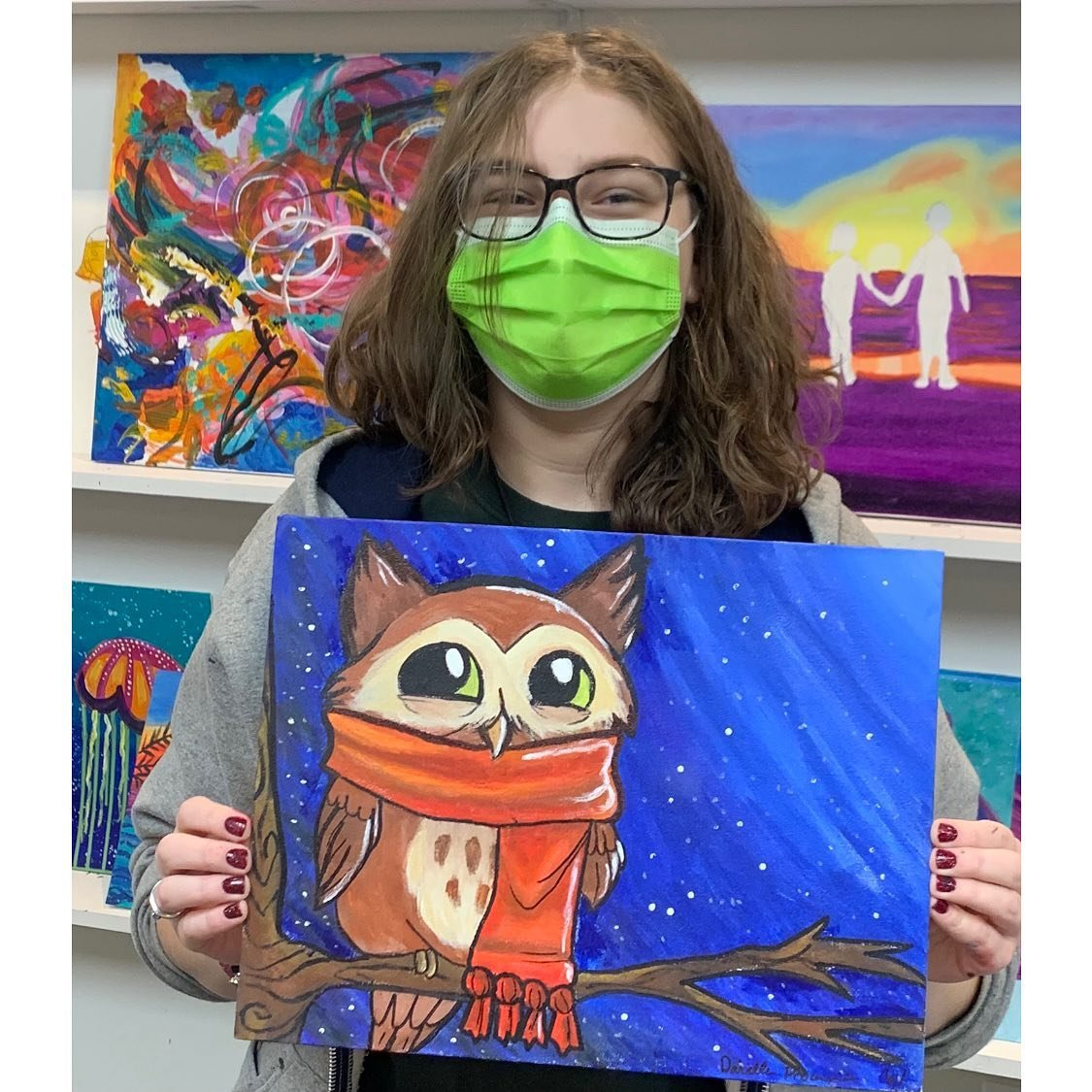 Daniella Procaccini, 15, with her canvas painting.