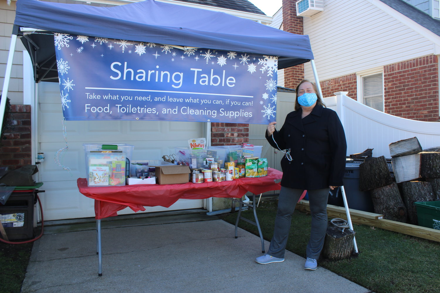 Diane Carannante started East Meadow's Sharing Table at her home on Sheila Court. She encourages residents to either drop off food and supplies or take any that they need.