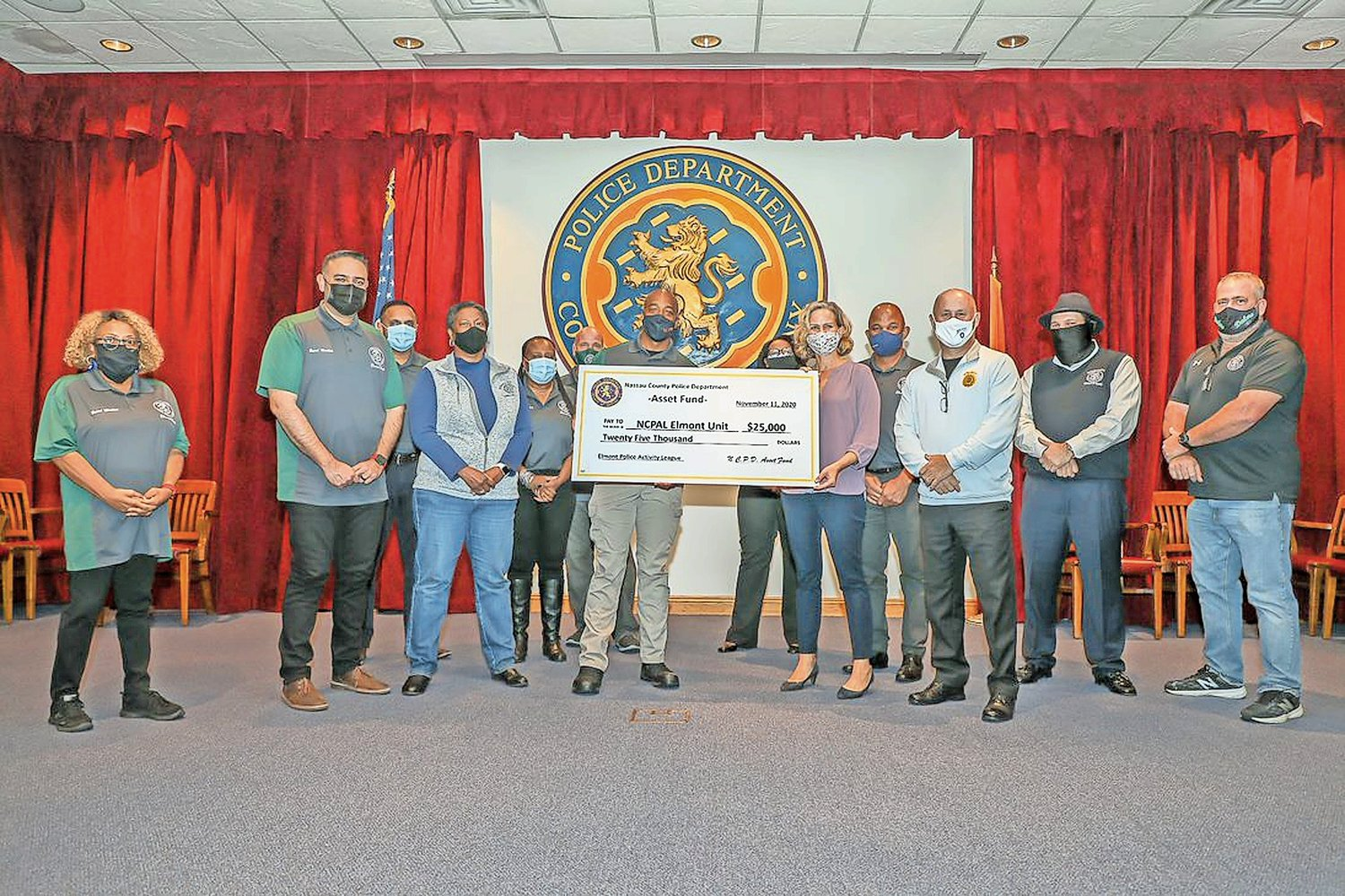 Nassau County officials presented Elmont residents with a $25,000 check for the creation of an Elmont Police Activity League in November.