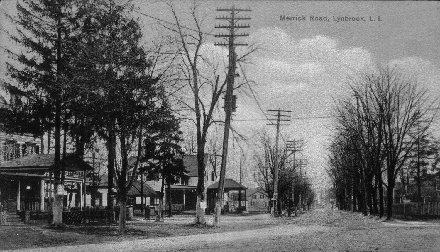"This is Lynbrook's Five Corners, in 1908, looking east along ""the Merrick Road,"" which was then an unpaved dirt road. Four years later, oyster shells were used as paving."