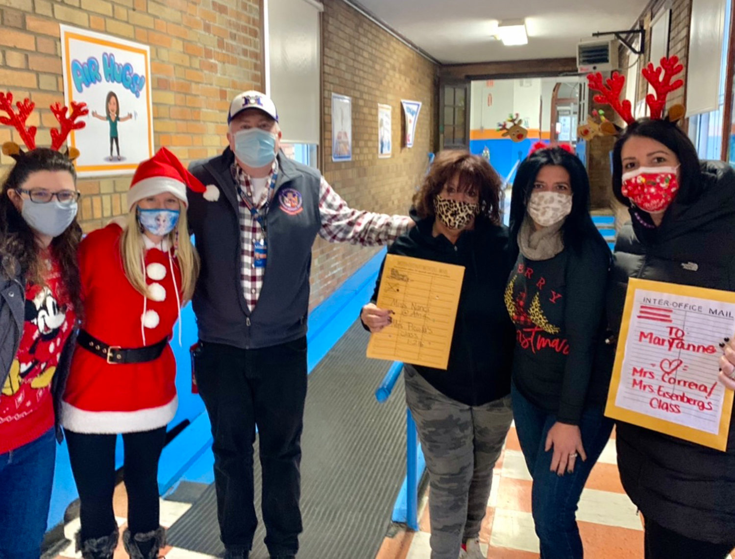 First-grade teachers at Maurice W. Downing Primary School helped students write holiday letters to their pen pals at the Atria Assisted Living in Lynbrook.