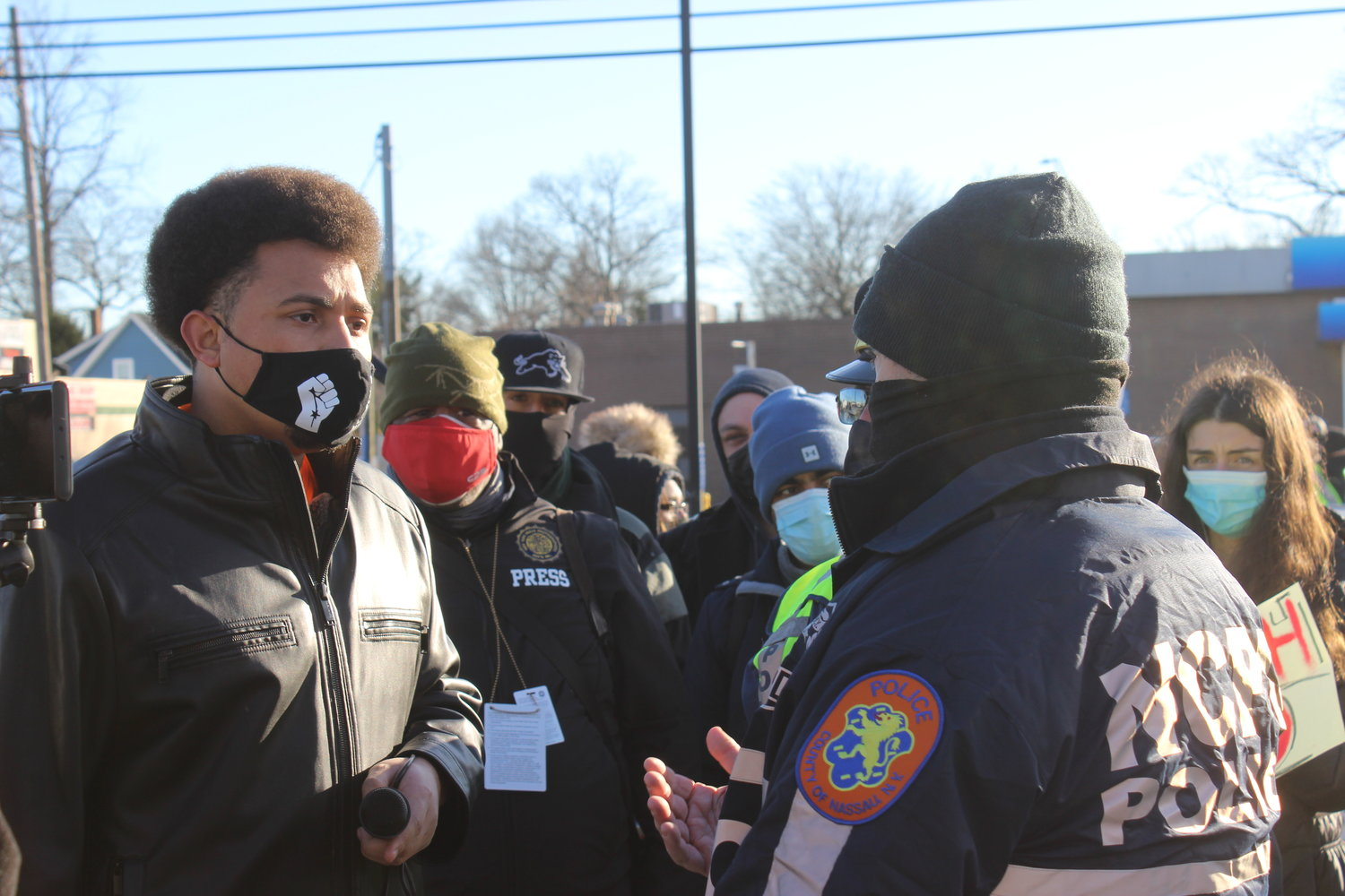 Tuosto spoke with Nassau County police officers before the march.