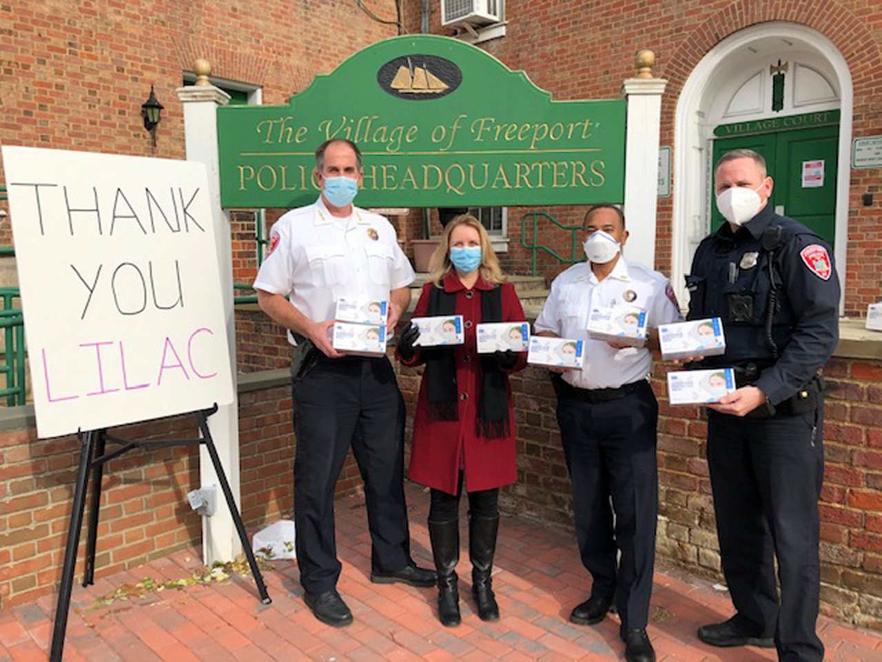 Freeport Police Chief Mike Smith, left, thanked Nassau County Legislator Debra Mulé, to his right, and Long Island Laboring Against Covid-19 for donating hundreds of masks on Jan. 8.