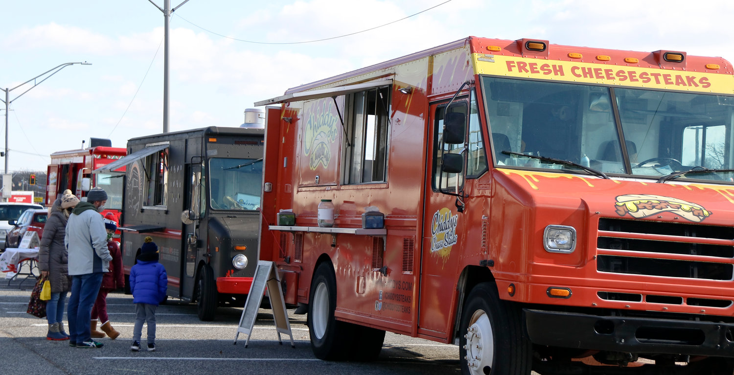 Food trucks park at the Bellmore train station for the weekly event.