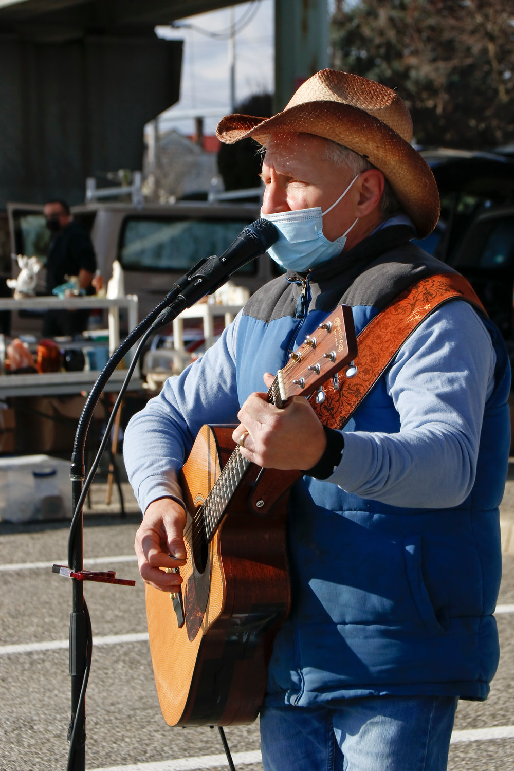 Because of the pandemic, The Guitar Guy, Russell Breiter, hasn't been able to perform indoors. He sang a variety of classic rock songs at the weekly outdoor market.
