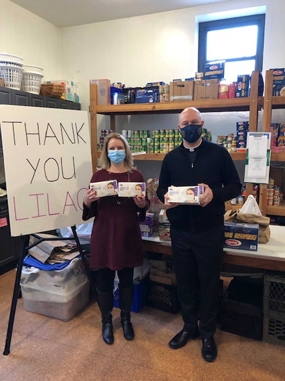 Nassau County Legislator Debra Mulé dropped off masks with the Rev. Nicholas Zientarski, of St. Christopher's Church in Baldwin, whose food pantry serves the food insecure.
