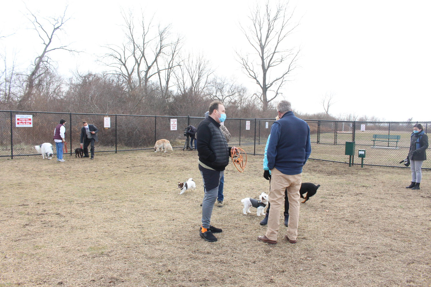Bellmore resident Scott Gold, center, with his dogs, Morty and Bailey, mingled with Town Supervisor Don Clavin, right, and other dog owners.