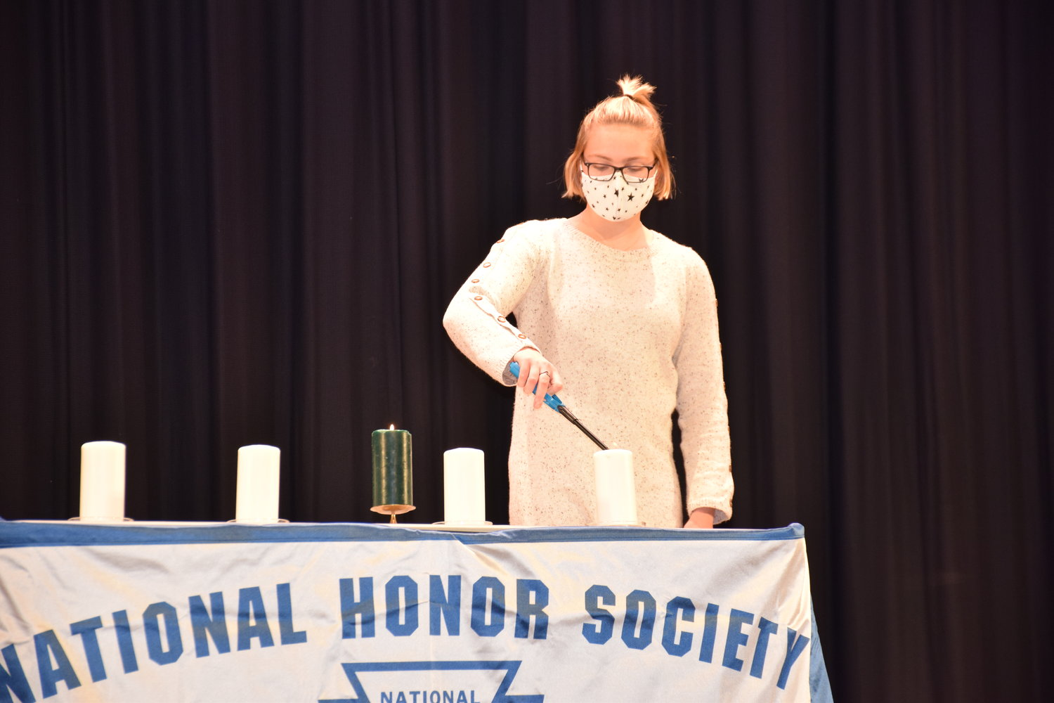 Alexandra Weilert, Locust Valley National Honor Society's secretary, lit a candle, which represented scholarship, during the virtual induction ceremony on Jan. 20.