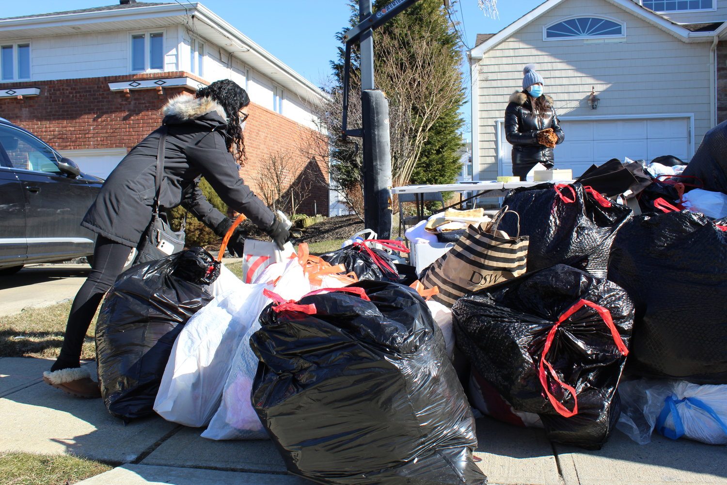 Dozens of residents dropped bags full of donations onto a      collection pile, which stretched the entire length of the Levines'  driveway and took up some of the sidewalk.