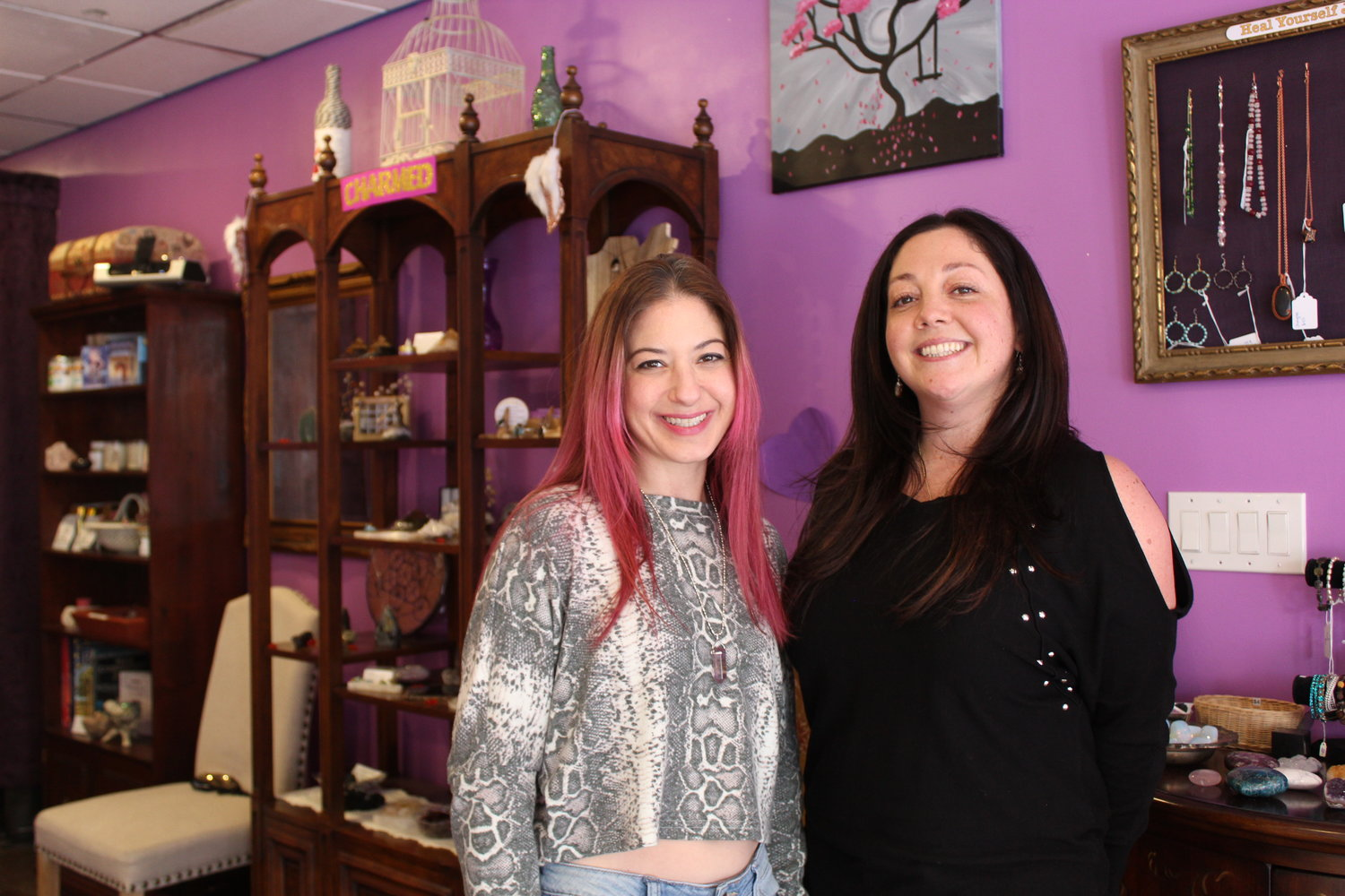 East Meadow residents Ilana Slavin, left, and Lori McGuire, have relocated their business, Charmed The Eclectic Healing Shoppe, to Bedford Avenue in Bellmore Village.