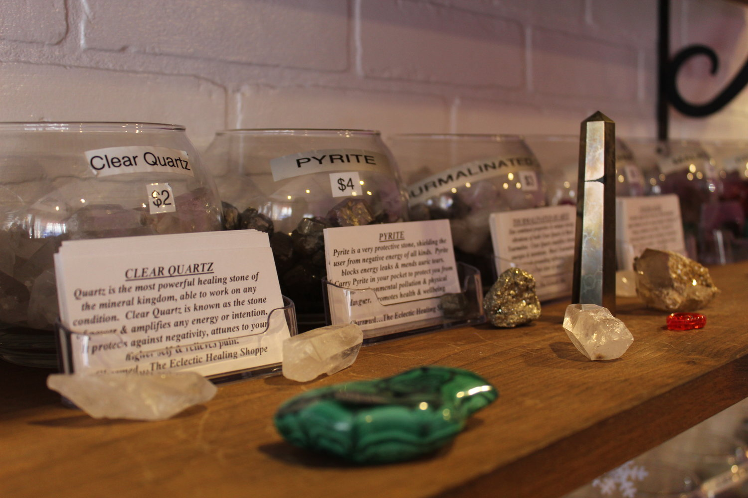 C: The shop's wall of crystals adds a magical touch to the cozy space, where the owners also host weekly meditation, yoga and reiki classes.