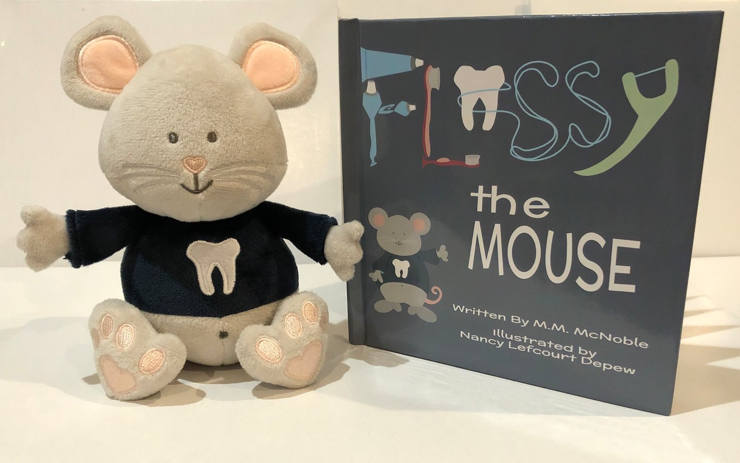 """Flossy the Mouse"" is sold as a set, with both the book and a plush toy Flossy, who will motivate children to brush their teeth."