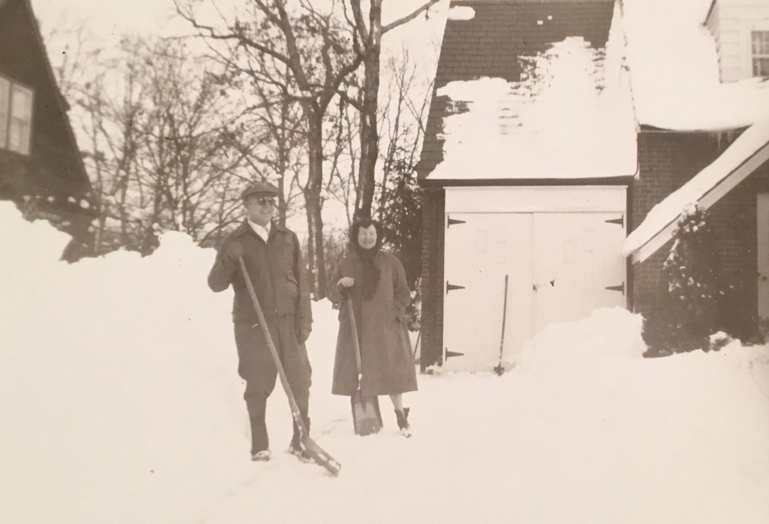 A West Hempstead couple shoveling snow by their garage after a blizzard in 1938.