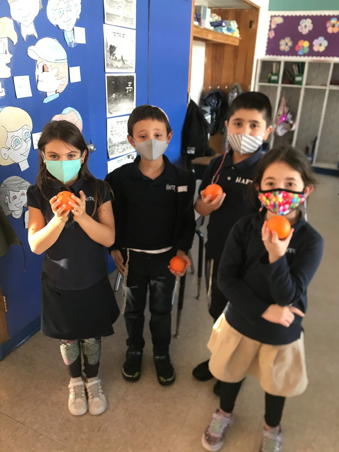 HAFTR second-graders Lexi Sobel, Meir Rubashkin,  Adam Simkhayev and Celine Vinkorov learned that fruit is healthier than candy.