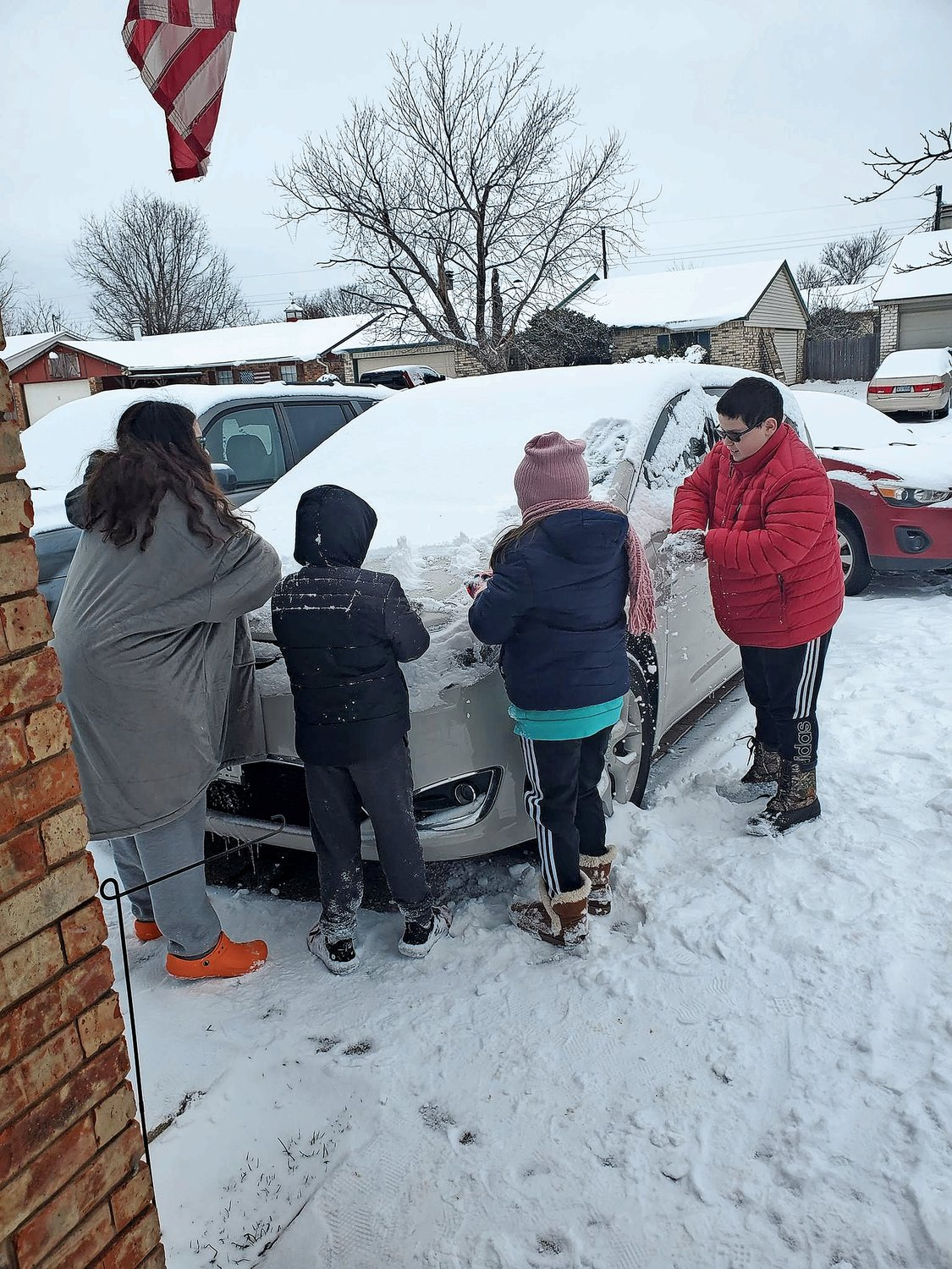 The Assa family cleared snow from their car after the storm on Presidents Day weekend.