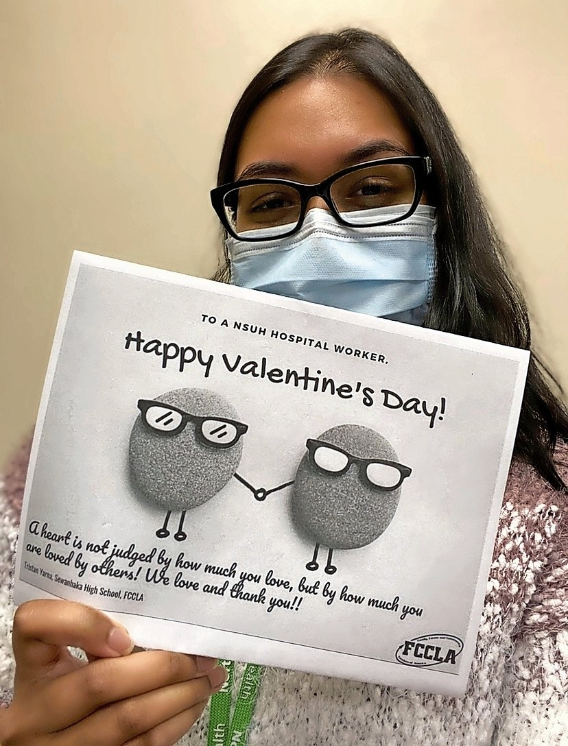 Amelia Gangapersaud, an infection control specialist at North Shore University Hospital, right, recently received one of the FCCLA Club's Valentine's Day cards.